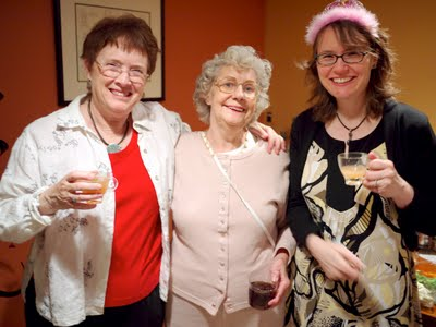 Three women celebrating.